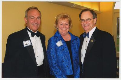 From the left:  Jim Stuckert, Diane Stuckert, and President Lee Todd.  They are at a ceremony for the reopening of the Main Building