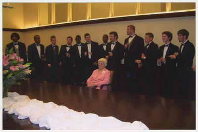 Betty Rosenthal is with the UK men's choral group the Acoustikats at a ceremony for the reopening of the Main Building
