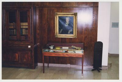 The lobby of the M. I. King Library.  There is a portrait of Laura Clay over an exhibit case