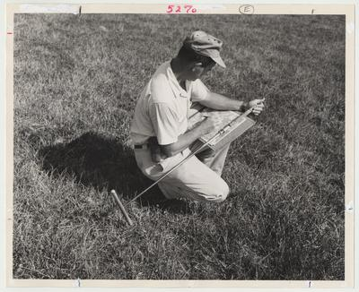 Orville Whitaker is noting soil type on an aerial photograph