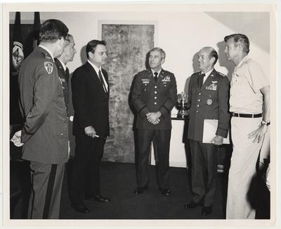Professor Vince Davis (dark suit), Director of the Patterson School of Diplomacy and International Commerce, is at the National War College in Washington DC.  In the center is the Commandant with is two aides at the left.  At the right are General W. Y. Smith, USAF, and LTG Bob Guard, USA.  Davis was a guest lecturer