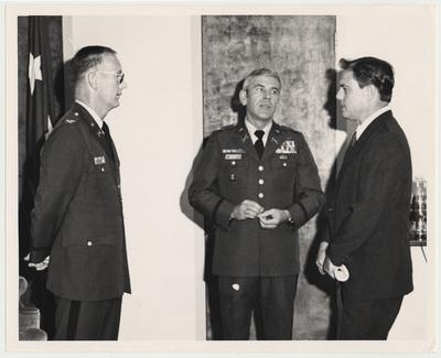 Professor Vince Davis (right), Director of the Patterson School, is at the National War College in Washington DC.  The man in the middle is the two-star commandant with his aide on the left.  David was a guest lecturer