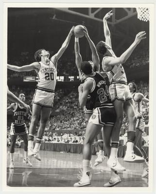 The University of Kentucky Men's Basketball Team versus the University of Illinois at Rupp Arena.  The Kentucky Players from the left:  Jim Master (#20) Sam Bowie, and Kenny Walker