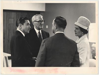 From the left:  Elvis Stahr, UK Alumnus, former Dean of the College of Law, and President of Indiana University; U. S. Senator John Sherman Cooper; Smith Broadbent, UK Alumnus and Board of Trustees member; Mrs. Broadbent.  They are talking to one another