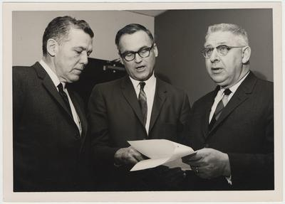 Members of the Energy Subcommittee of the Kentucky Science and Technology Commission discuss the agenda of a meeting held at the University of Kentucky.  From the left:  Chairman Sam Cassidy, Executive Director D. W. A. Lambertson, and Dr. Ronald Reitmeier
