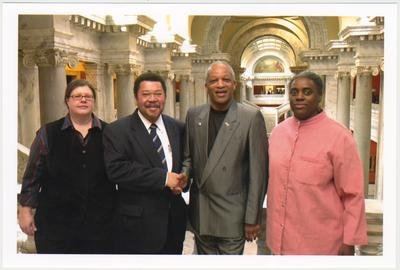 From the left:  Kathy Schiflett, Administrative Office of the Courts; Kentucky Representative Jesse Crenshaw; Cecil R. Madison, Sr. of UK Libraries; and Reinette F. Jones, UK Libraries.  The photograph was taken in the Capitol
