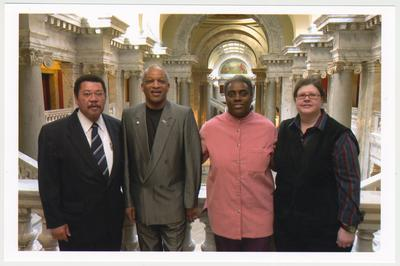 From the left:  Kentucky Representative Jesse Crenshaw;  Cecil R. Madison, Sr., of UK Libraries; Reinette F. Jones, UK Libraries; and Kathy Schiflett, Administrative Office of the Courts.  The photograph was taken in the Capitol