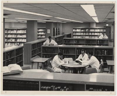 Unidentified men are reading in the Medical Center Library
