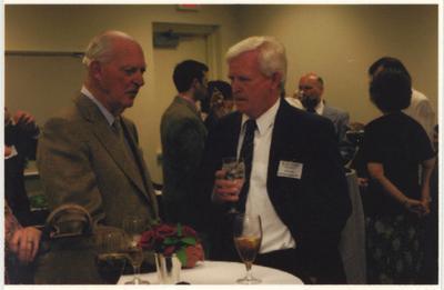 Ted Bassett (left), of the Keeneland Association, speaks with Dr. John Timoney