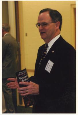 UK President Lee Todd holds a brochure about veterinary science