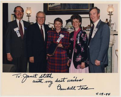 From the left:  an unidentified man; US Senator Wendell Ford; Janet Stith, director of the Medical Center Library; an unidentified woman; and an unidentified man.  The photograph is autographed,