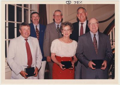The 1995 Alumni Association Service Awards.  From the left:  Preston Art, Mike Burleson, Bernie Vonderheide, Barbara Letton, C. M. Newton, and Ed Hamilton