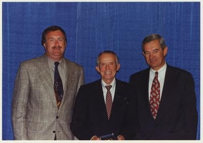 The 1994 Alumni Association Service Awards.  From the left:  Michael A. Burleson, Thomas W. Harris, and Joseph Burch