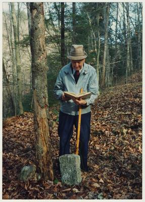 Dr. Thomas D. Clark is reading at William Baker's grave at the mouth of Gabriel, Right Fork of Buffalo, Owsley County, Kentucky
