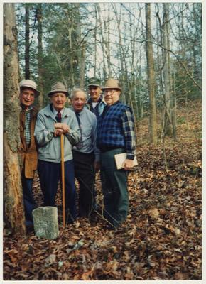 From the left:  Jess Wilson; Dr. Thomas Clark; Stanley Deizarn; A. B. Couch, Postmaster at Mistletoe; and Dennie Campbell.  They are at William Baker's grave at the mouth of Gabriel, Right Fork of Buffalo, Owsley County, Kentucky