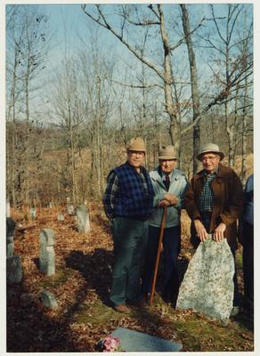 From the left:  Dennie Campbell, Dr. Thomas D. Clark, and Jess Wilson at a grave site