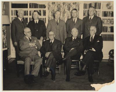 Back row from the left:  Samuel L. Wilson, Herman D. Donovan, Dr. J. S. Chambers, Thomas D. Clark, and J. Winston Coleman.  Front row from the left:  C. R. Staples, Dr. Claude Trapp, W. H. Townsend, and Dr. Frank McVey.  They are at the home of Thomas D. Clark, 248 Tahoma Rd., Lexington