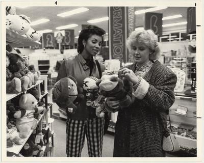 Avis Lay (left) and Amy Figg look at stuffed animals in the bookstore