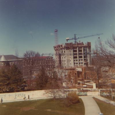 A color photo of the construction of White Hall Classroom Building (right) and Patterson Office Tower (next to White Hall) near the Administration Building (center) and Miller Hall (left). This photo was taken from the window in room 518 in King Library on April 1, 1968 and donated by Terry Warth