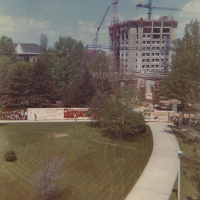 A color photo of the construction of White Hall Classroom Building (right) and Patterson Office Tower (next to White Hall) near the Administration Building (center) and Miller Hall (left). This photo was taken from the window in room 517 in King Library on April 25, 1968 and donated by Terry Warth