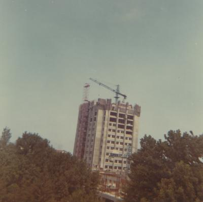 A color photo of the construction of White Hall Classroom Building (right) and Patterson Office Tower (next to White Hall). This photo was taken from the window in room 517 in King Library on July 30, 1968 and donated by Terry Warth