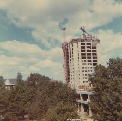 A color photo of the construction of White Hall Classroom Building (right) and Patterson Office Tower (next to White Hall) near Miller Hall (left). This photo was taken from the window in room 518 in King Library on September 12, 1968 and donated by Terry Warth