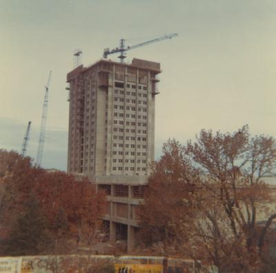 A color photo of the construction of White Hall Classroom Building (right) and Patterson Office Tower (next to White Hall). This photo was taken from the window in room 518 in King Library on November 15, 1968 and donated by Terry Warth