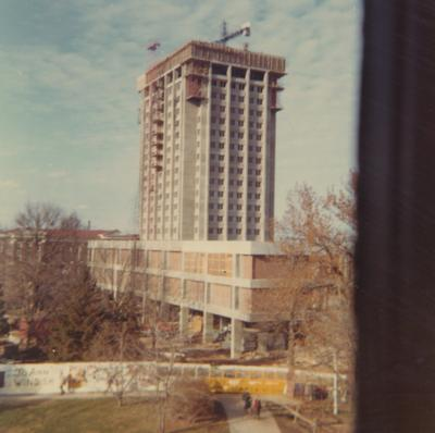 A color photo of the construction of White Hall Classroom Building (right) and Patterson Office Tower (next to White Hall) near the Administration Building (background). This photo was taken from the window in room 518 in King Library on December 9, 1968 and donated by Terry Warth
