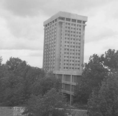 Unidentified men are dismantling the outside elevator of the Patterson Office Tower (next to White Hall). White Hall Classroom Building (right) is finishing constructions and is near Miller Hall (left). This photo was taken from the window in room 517 in King Library on May 5, 1969 and donated by Terry Warth