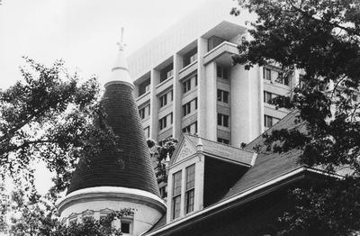 A picture of the top of Patterson Office Tower and the top of Gillis Building