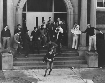 A group of unidentified students outside of Pence Hall. This photo appears first on page 144 in the 1969
