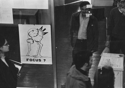 Unidentified students walking in a hallway in Pence Hall. This photo appears first on page 160 in the 1969