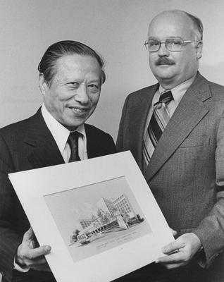 Dr. Peter Bosomworth (Chancellor), on the right, and an unidentified man on the right are holding an architectural drawing of the Medical Center. Received April 12, 1996 from the Medical Center Chancellor