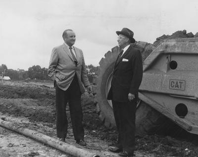 Dr. Peterson and Mr. Farris at new athletic center site. Received September 18, 1958 from Public Relations