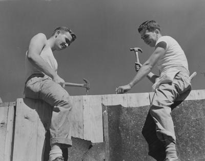 Student carpenters Redwood Taylor (left) and Paul Grumbles (right), both from Ashland, Kentucky, are helping to build Veteran housing