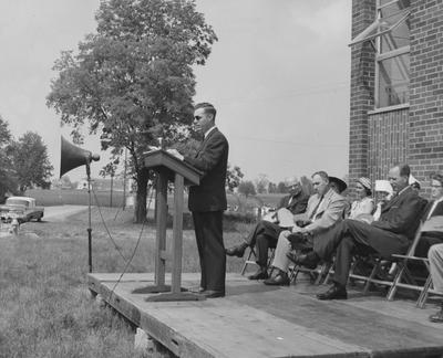 Dr. Dickey addresses a crowd at the Shawneetown Apartments dedication. Received May 21, 1958 from Public Relations