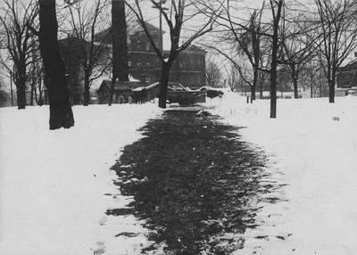 View above Steam Mains running from Heating Plant to Old Chemistry Building (Miller Hall). Path is clear of snow because of heat from underground pipes. Received January of 1953 from Dr. McVey's files