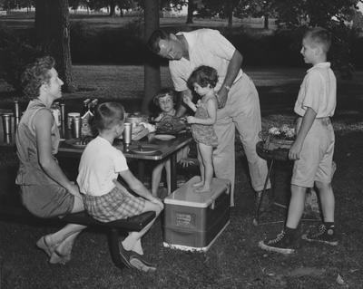 Family during a cookout. Received October 19, 1960 from Public Relations. Lexington Herald-Leader Photo