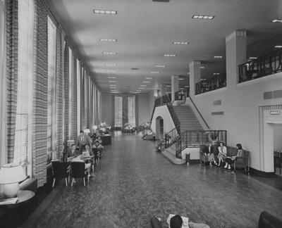 Inside of Student Center; students reading papers and talking