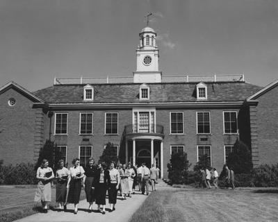 People walking to and from the Taylor Education Building. Received June of 1952 from Public Relations
