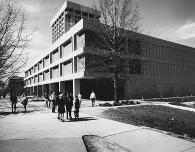 Unidentified students walking past the White Hall Classroom Building
