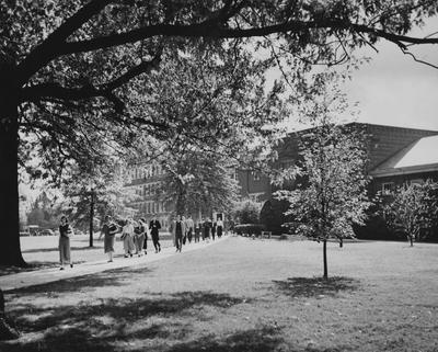 Pence Hall, Mining Lab and Engineering Lab; students walking from class, holding books. Photographer: Ben. L. Williams. Received October 29, 1949 from Public Relations