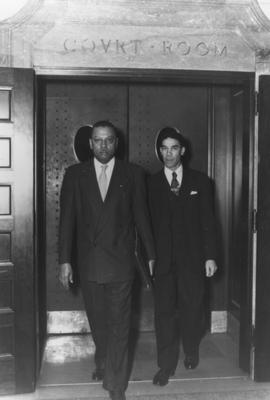 Lyman Johnson, right, and Kentucky State University President R. B. Atwood, leave federal district court in Lexington, after the court ruled in favor of Johnson's admission to the University of Kentucky