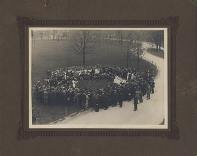 Arbor Day Exercises--Arbor Day is a tradition where every year the senior class assembles and has a ceremony and plants a tree. This photo appears on page 73 in the 1915