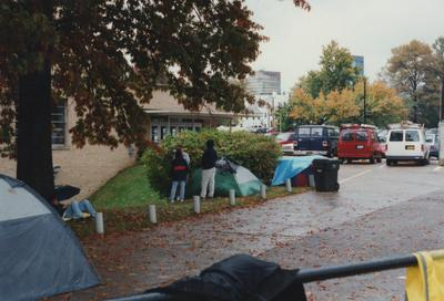 Unidentified people standing and camping out near Memorial Coliseum for