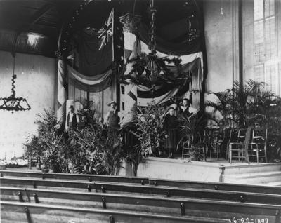 Administrative Building interior chapel decorated for the British Educational Mission Visit, June 22, 1897. Pews in chapel, palm plants decorated the chapel for this occasion. President Patterson was very excited to host the delegates