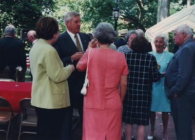 Celebration: July 11, 2002; Actual Birthday: July 16, 2002. Robert Milward and wife Eleanor, she is wearing an orange dress, and Dick Cooper is to the far right
