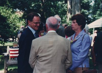 Celebration: July 11, 2002; Actual Birthday: July 16, 2002. Left to right: Dr. Todd and two unidentified people