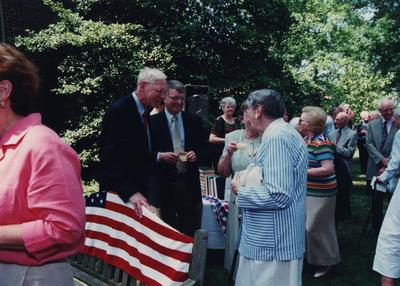 Celebration: July 11, 2002; Actual Birthday: July 16, 2002. Left to right: unidentified man, Bill and Jan Marshall, both holding punch cups, and Dr. Mary W. Hargreaves in a striped suit
