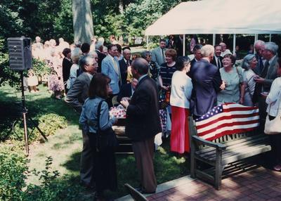 Celebration: July 11, 2002; Actual Birthday: July 14 1903. George Herring, Foster Okerman (wearing blue jacket in the back), Mary Molinaro (red skirt), John Cleaver, Jan Marshall (in light green suit), Loretta Clark, wife of Thomas D. Clark. On the far right: Lindsay Apple, Georgetown College professor